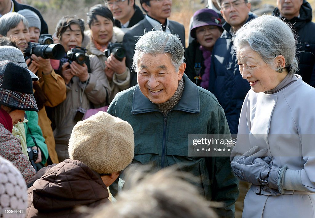 Emperor Akihito and Empress Michiko speak to local residents near Hayama Villa on February 7, 2013 in Hayama, Kanagawa, Japan.