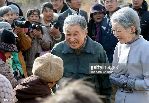 Emperor Akihito and Empress Michiko speak to local residents near Hayama Villa on February 7 2013 in Hayama Kanagawa Japan