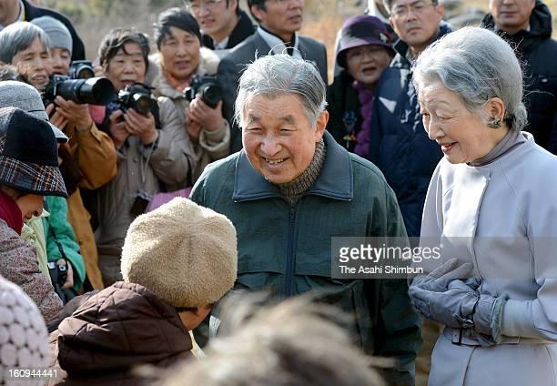 Emperor Akihito and Empress Michiko speak to local residents near Hayama Villa on February 7, 2013 in Hayama, Kanagawa, Japan.