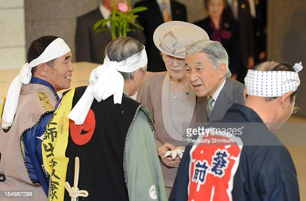 Emperor Akihito and Empress Michiko speak to performers of Tohoku region's traditional horse festivals 'Soma Nomaoi' of Fukushima and 'Chagu Chagu...