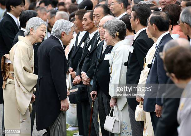 Emperor Akihito and Empress Michiko speak to the Nobel Prize laureate Isamu Akasaki and his wife Ryoko during the spring garden party at Akasaka...