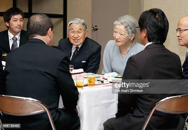 Emperor Akihito and Empress Michiko speak with staffs during a tea party to celebrate their 80th birthday hosted by the Imperial Household Agency at...
