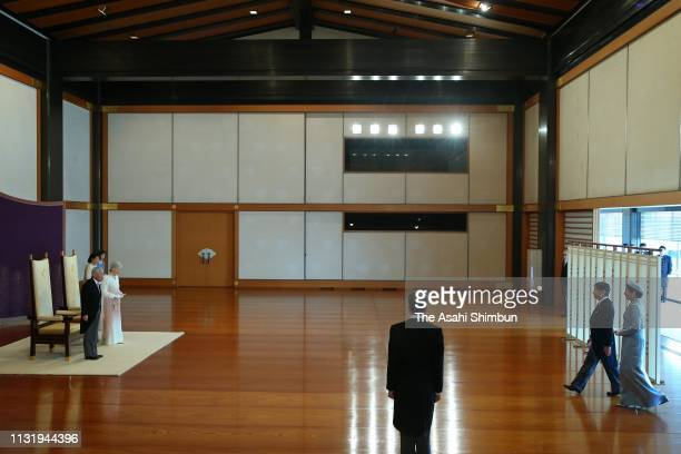 Emperor Akihito and Empress Michiko stand while Crown Prince Naruhito and Crown Princess Masako enter the room during the ceremony marking the 30th...