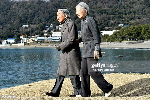 Emperor Akihito and Empress Michiko stroll outside the Hayama Imperial Villa on February 5, 2016 in Hayama, Kanagawa, Japan.