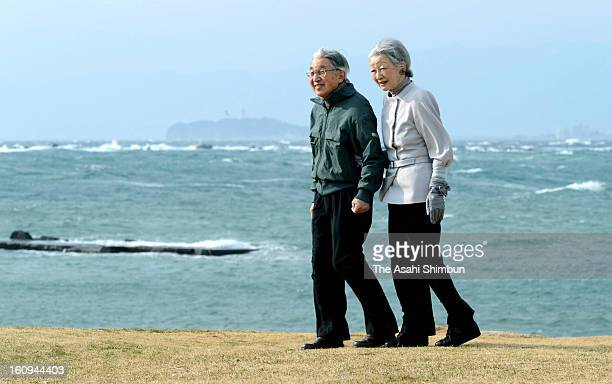Emperor Akihito and Empress Michiko take a walk a coast near Hayama Villa on February 7 2013 in Hayama Kanagawa Japan