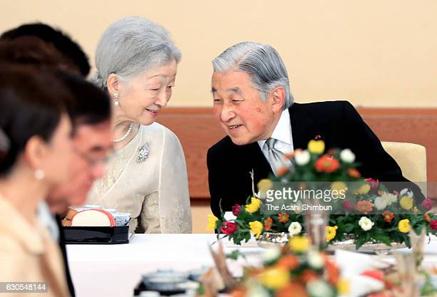 Emperor Akihito and Empress Michiko talk during a banquet at the Imperial Palace on December 23 2016 in Tokyo Japan