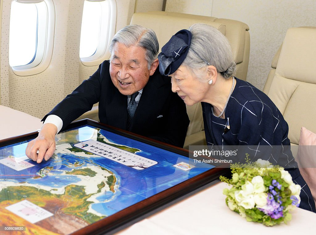 Emperor Akihito and Empress Michiko talk in front of the map on the way to the Phillippines on January 26, 2016 in flight. The 5-day visit, their first since 1962 when they were crown prince and princess, is the latest in a series of trips to mourn wartime victims across the Asia-Pacific region.