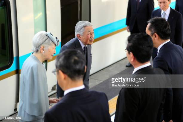 Emperor Akihito and Empress Michiko talk on departure at Kashikojima Station on April 19, 2019 in Shima, Mie, Japan. The emperor will abdicate at the...
