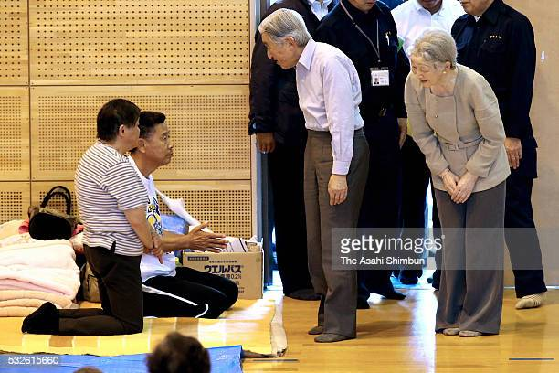 Emperor Akihito and Empress Michiko talk to evacuees at the gymnasium of the Minamiaso Junior High School where people take shelter on May 19 2016 in...