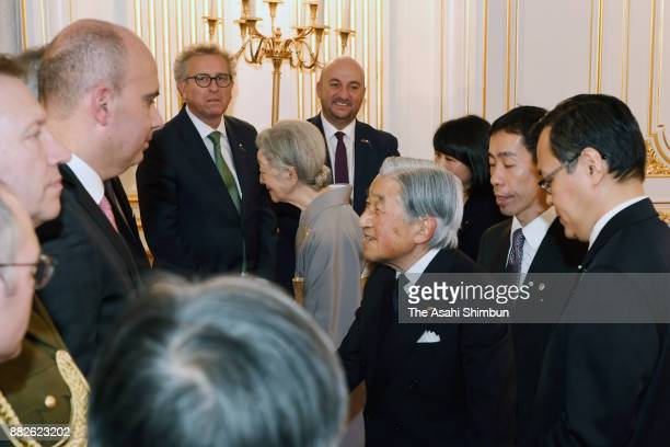 Emperor Akihito and Empress Michiko talk to staffs of Grand Duke Henri of Luxembourg and his daughter Princess Alexandra of Luxembourg at the Akasaka...