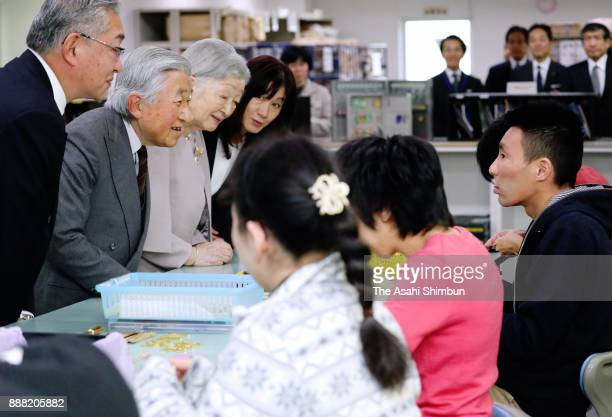 Emperor Akihito and Empress Michiko talk to workers at Mitsukoshi Isetan Soleil Ochiai Center on December 8 2017 in Tokyo Japan The royal couple...