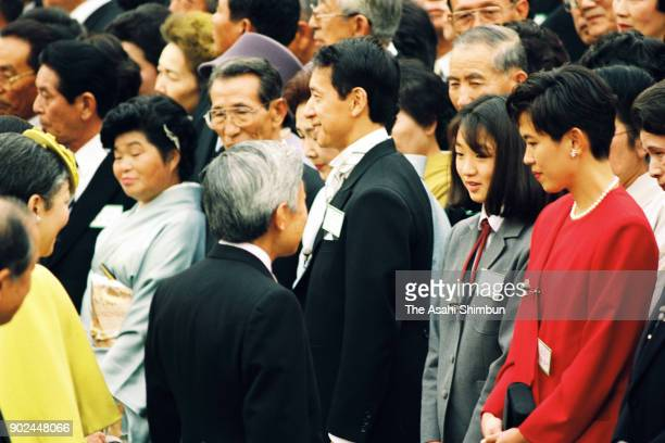 Emperor Akihito and Empress Michiko talk with astronaut Mamoru Mori and swimmer Kyoko Iwasaki during the Autumn Garden Party at the Akasaka Imperial...