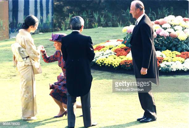 Emperor Akihito and Empress Michiko talk with Crown Prince Harald of Norway and his wife Crown Prince Sonja of Norway during the garden party...