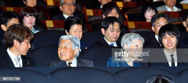 Emperor Akihito and Empress Michiko talk with film director Kojiro Hashimoto and actor Keto Yamazaki during a special premiere of the 'Hitsuji to...