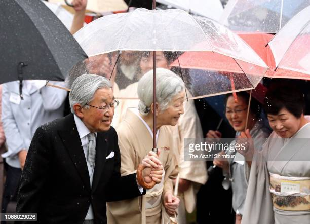 Emperor Akihito and Empress Michiko talk with guests during the Autumn Garden Party at Akasaka Imperial Garden on November 09 2018 in Tokyo Japan