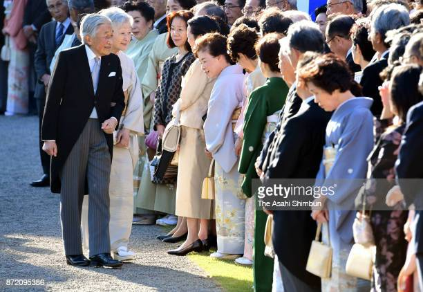 Emperor Akihito and Empress Michiko talk with guests during the Autumn Garden Party at the Akasaka Imperial Garden on November 9 2017 in Tokyo Japan