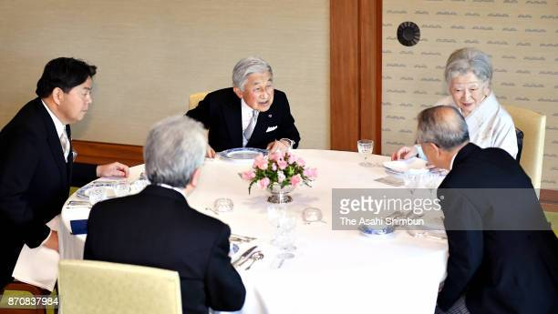 Emperor Akihito and Empress Michiko talk with guests during the tea party with Order of Culture laureates at the Imperial Palace on November 6 2017...