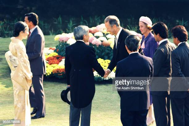Emperor Akihito and Empress Michiko talk with King Baudouin and Queen Fabiola of Belgium during the garden party celebrating his Enthronement at the...