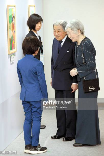 Emperor Akihito and Empress Michiko talk with laureates of the National TreePlanting festival drawing contest at Spa Resort Hawaiians on June 9 2018...