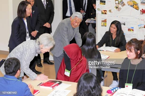 Emperor Akihito and Empress Michiko talk with people at the Hamamatsu Foreign Resident Study Support Center on November 28 2018 in Hamamatsu Shizuoka...