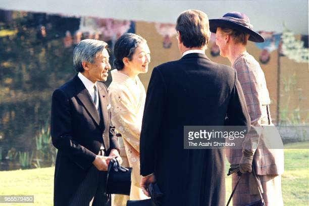 Emperor Akihito and Empress Michiko talk with Queen Margrethe II and her husband Prince Henrik of Denmark during the garden party celebrating his...