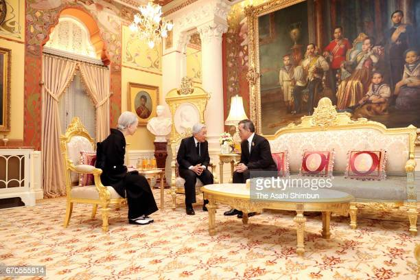Emperor Akihito and Empress Michiko talk with Thai King Maha Vajiralongkorn after paying their respects to the late King Bhumibol Adulyadej at the...