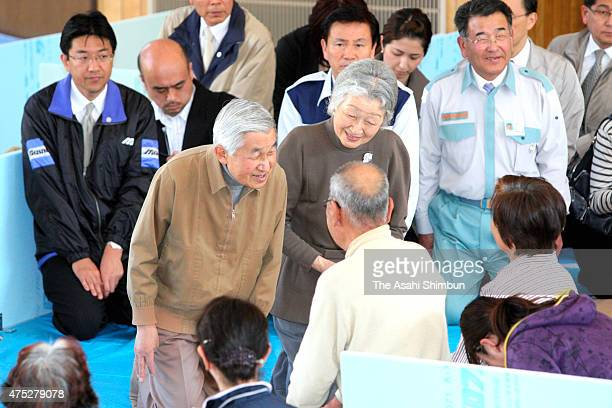 Emperor Akihito and Empress Michiko talks to evacuees to encourage the earthquake and following tsunami survivor at an evacuation center on April 14...