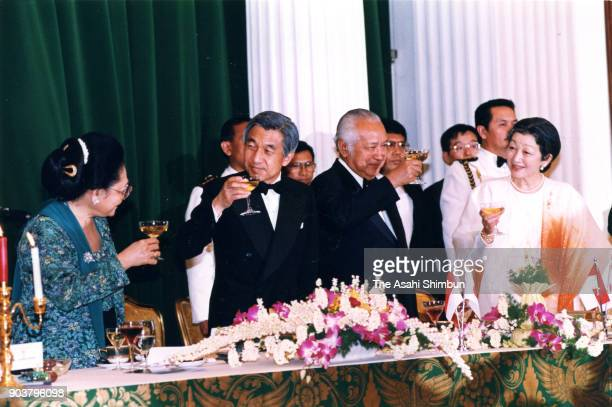 Emperor Akihito and Empress Michiko toast glasses with Indonesian President Muhammad Suharto and his wife Siti Hartinah during the dinner at the...