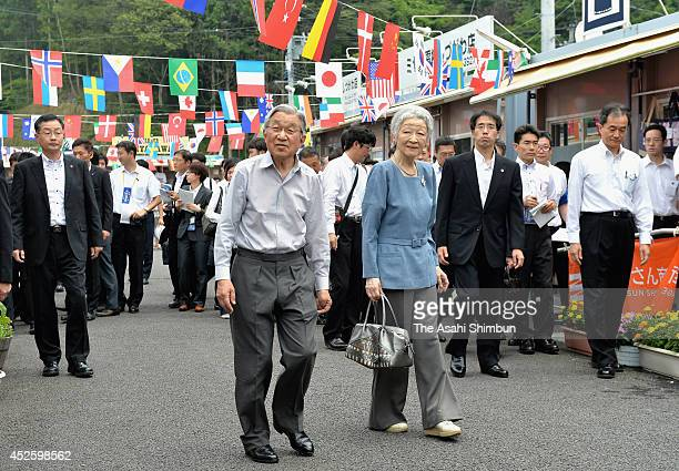 Emperor Akihito and Empress Michiko tour shops in the MinamiSanriku Sun Sun Shopping Village on July 23 2014 in Minamisanriku Miyagi Japan They offer...