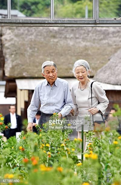 Emperor Akihito and Empress Michiko visit the Benibana Shiryokan Safflower Resource Centre on June 18 2015 in Kahoku Yamagata Japan