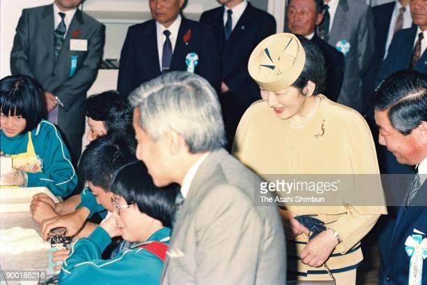 Emperor Akihito and Empress Michiko visit the Miyagi Prefecture Rifu School For Handicapped Children on October 6 1992 in Rifu Miyagi Japan