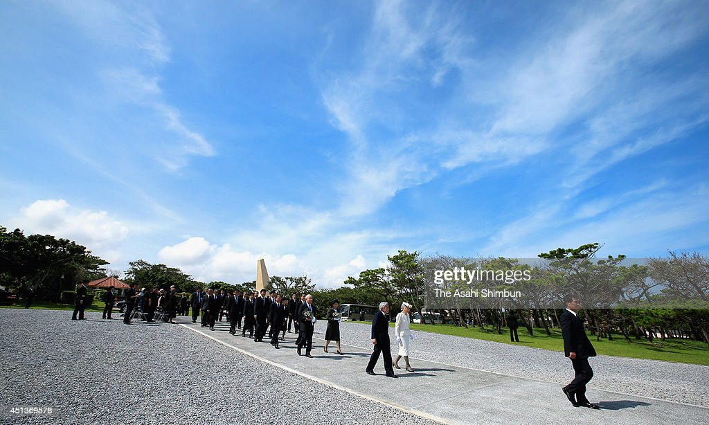 Emperor Akihito and Empress Michiko walk toward the memorial on their visit at the Cemetery for the victims of Battle of Okinawa on June 26, 2014 in Itoman, Okinawa, Japan.