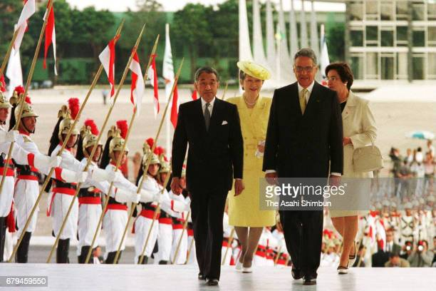 Emperor Akihito and Empress Michiko walk with Brazilian President Fernando Henrique Cardoso and his wife Ruth Cardoso after the welcome ceremony at...