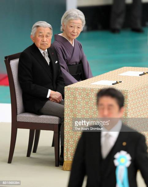 Emperor Akihito and Empress Michiko watch as Prime Minister Shinzo Abe walks to the stage to address during the national memorial ceremony for the...