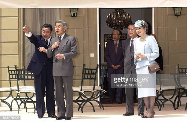 Emperor Akihito and Empress Michiko watch Lake Geneva at the official residence of the Permanent Representative of Japan to the International...