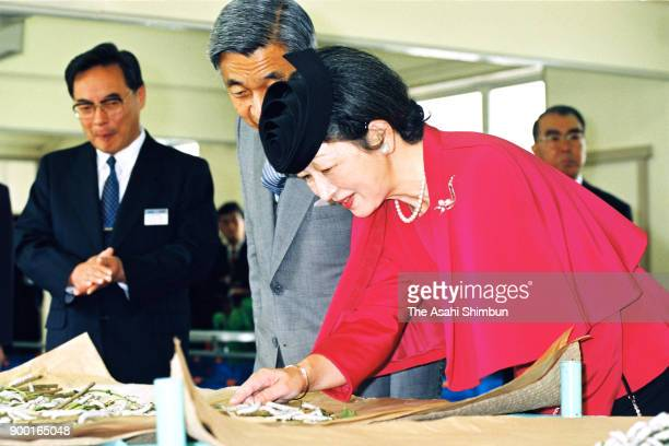 Emperor Akihito and Empress Michiko watch silkworms at the Yamagata Prefecture Silk Cultivation Research Center on October 5 1992 in Murayama...
