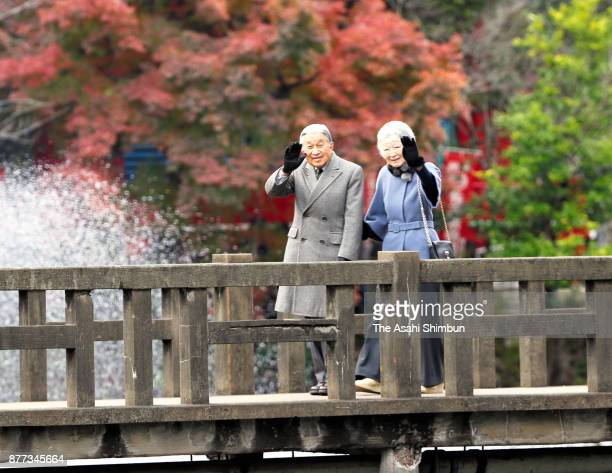 Emperor Akihito and Empress Michiko wave during their visit to Inokashira Park on November 22 2017 in Musashino Tokyo Japan