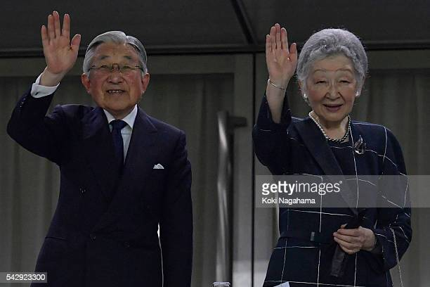 Emperor Akihito and Empress Michiko wave to audience during the international friendly match between Japan v Scotland at Ajinomoto Stadium on June 25...