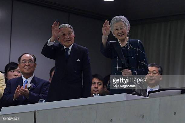 Emperor Akihito and Empress Michiko wave to audience on arrival during the international friendly match between Japan v Scotland at Ajinomoto Stadium...