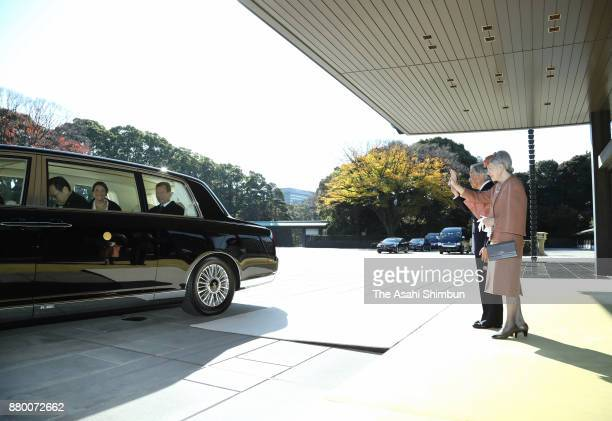 Emperor Akihito and Empress Michiko wave to Grand Duke Henri of Luxembourg and his daughter Princess Alexandra of Luxembourg after their meeting at...