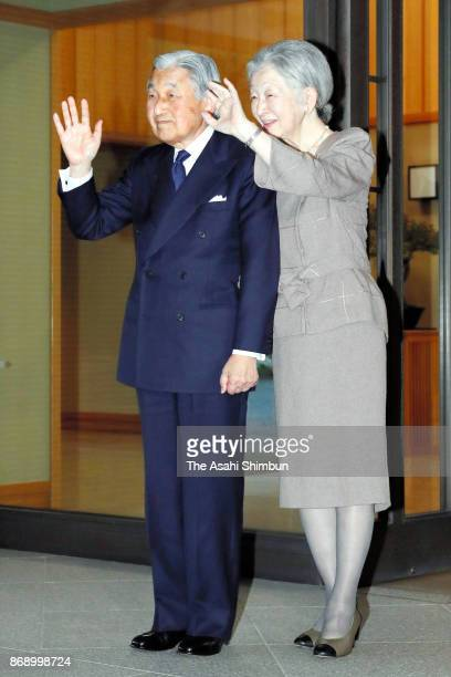 Emperor Akihito and Empress Michiko wave to Philippines President Rodrigo Duterte and his partner Cielito Avancena after their meeting at the...