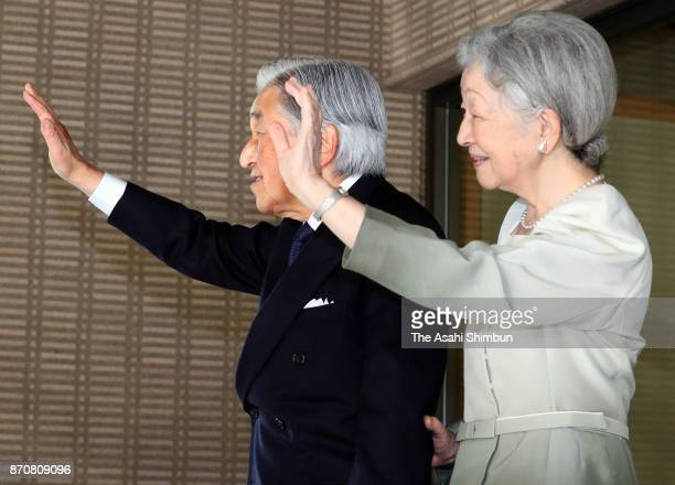 Emperor Akihito and Empress Michiko wave to US President Donald Trump and his wife Melania after their meeting at the Imperial Palace on November 6...