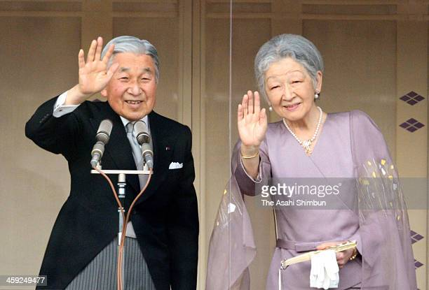 Emperor Akihito and Empress Michiko wave to wellwishers at the Imperial Palace on December 23 2013 in Tokyo Japan Emperor Akihito turns 80