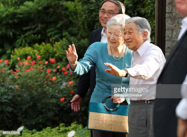 Emperor Akihito and Empress Michiko wave to wellwishers at the 'NemunokinoNiwa' garden where the empress' parents home used to stand on June 24 2018...