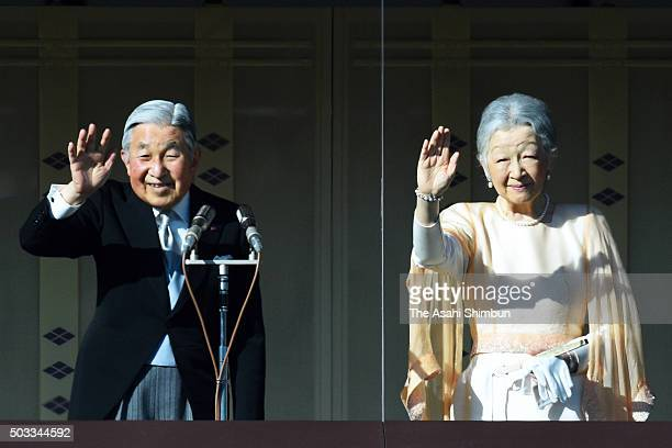Emperor Akihito and Empress Michiko wave to wellwishers during the New Year celebration at the Imperial Palace on January 2 2016 in Tokyo Japan