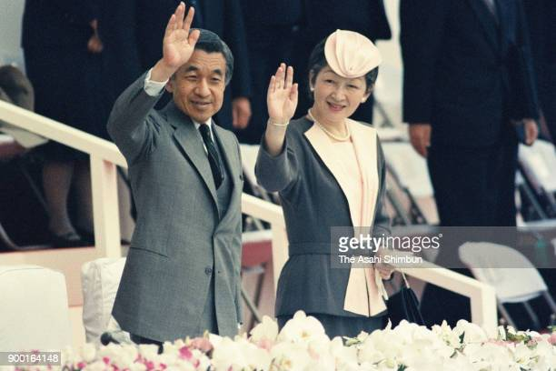 Emperor Akihito and Empress Michiko wave to wellwishers during the opening ceremony of the national sports festival Yamagata Prefecture Athletic...