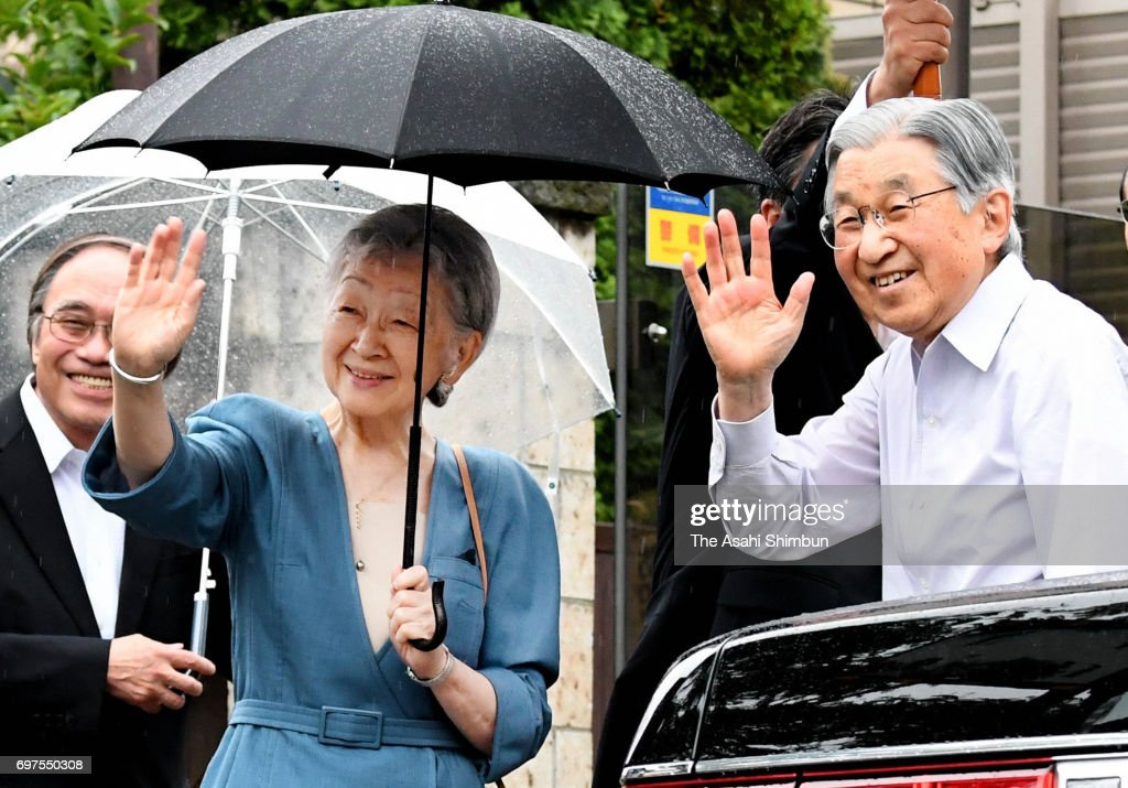 Emperor Akihito and Empress Michiko wave to well-wishers during their visit the Nemunoki-no-Niwa garden, where the home of parents of the empress used to stand, on June 18, 2017 in Tokyo, Japan.