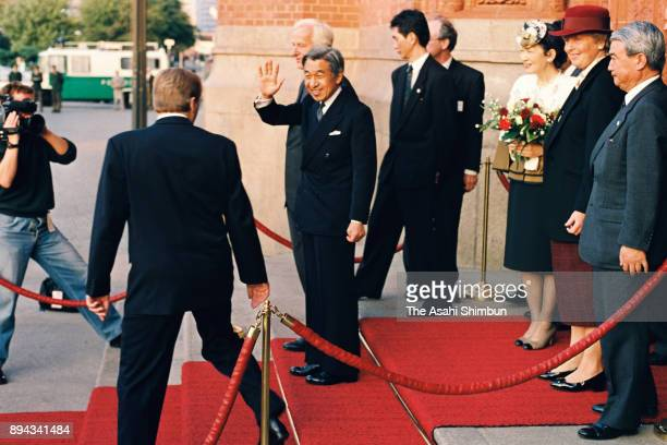 Emperor Akihito and Empress Michiko wave to wellwishers during their visit to the Berlin City Hall on September 15 1993 in Berlin Germany