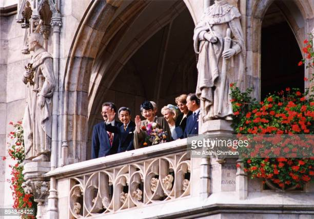 Emperor Akihito and Empress Michiko wave to wellwishers during their visit to the Munich City Hall on September 17 1993 in Munich Germany