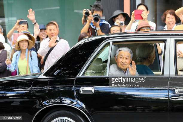 Emperor Akihito and Empress Michiko wave to well-wishers on arrival at the Karuizawa-Kai Tennis court, where they first met some 60 years ago, on...